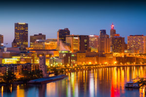 Downtown Saint Paul skyline at dusk / sunset with the Mississippi River in the foreground.  Saint Paul is part of the Minneapolis-Saint Paul Twin Cities area.